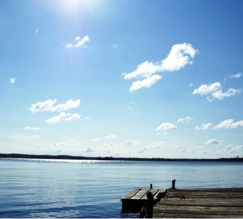 The trouble with reading out on the dock are the distractions: sky, water, dragonflys, clouds. Highly annoying.