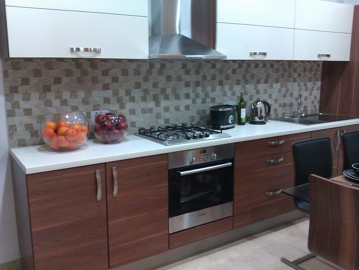 Fully equipped brand new kitchen with Bosch appliances including microwave