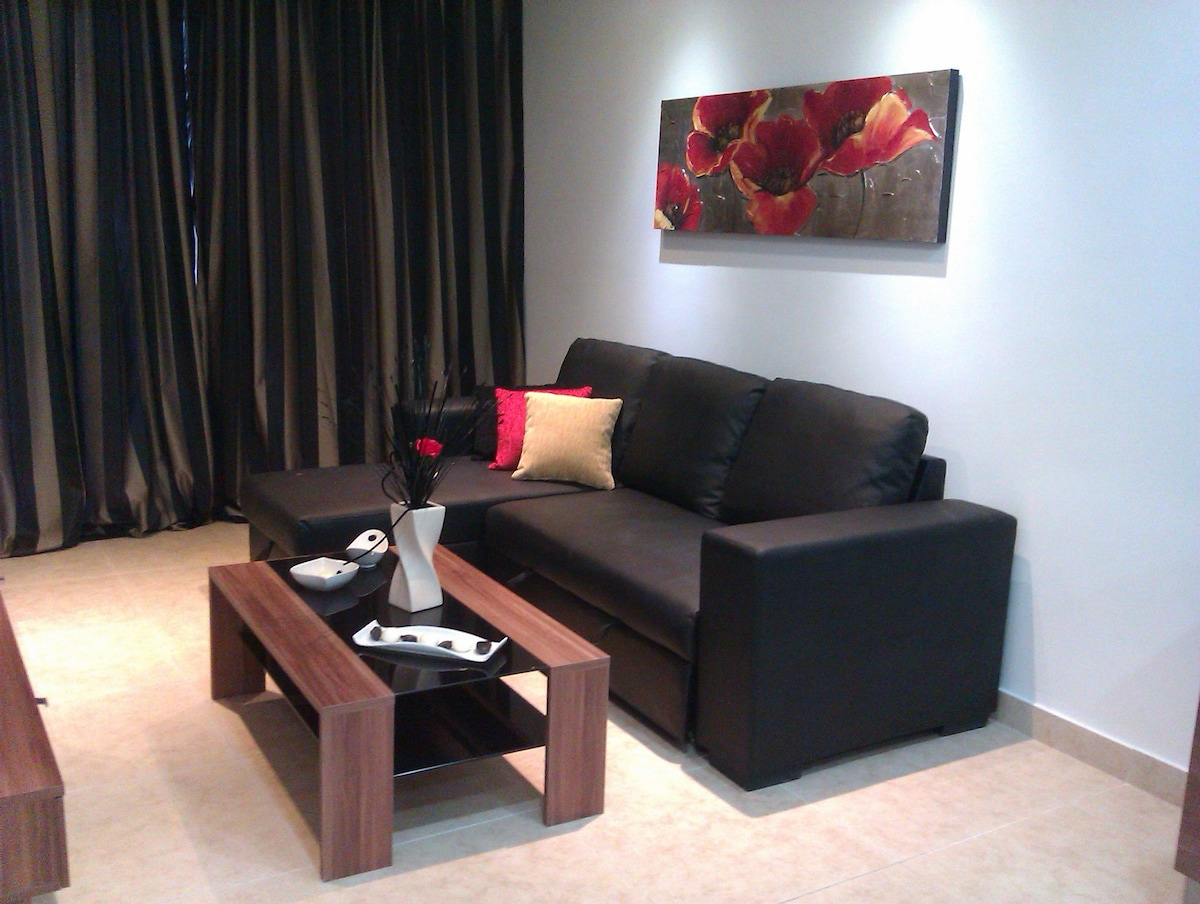 Sofa in sitting room with LED digital TV, Internet and telephone