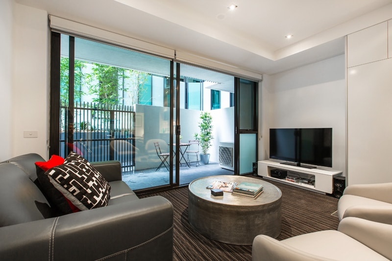 super stylish living and entertainment leading to private front courtyard