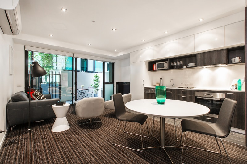 open plan living, dining & kitchen zone leading to courtyard
