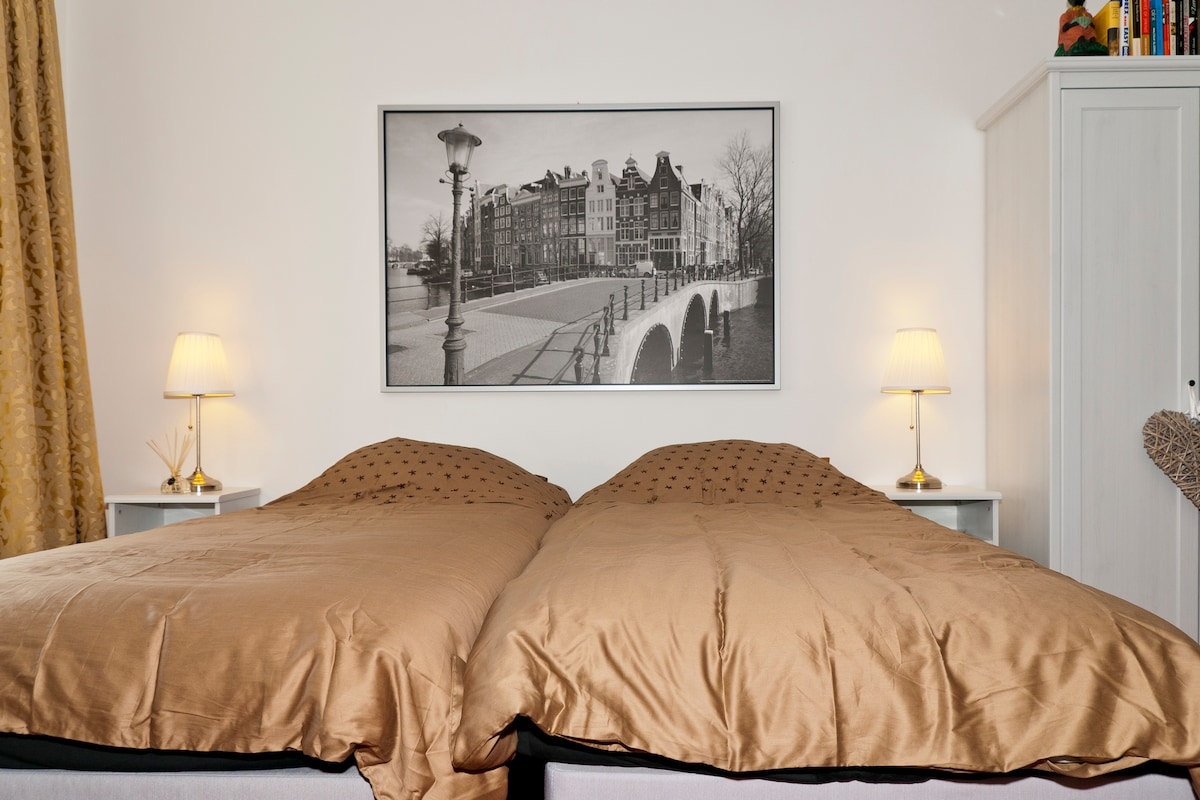 The beds - two single beds with a small lamp on the tiny closit