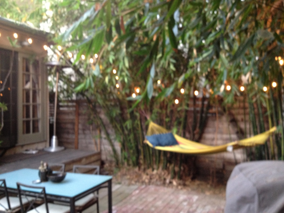 Sun setting at dusk on your bamboo patio. Enjoy from view of this hammock, peace and quiet, all yours!