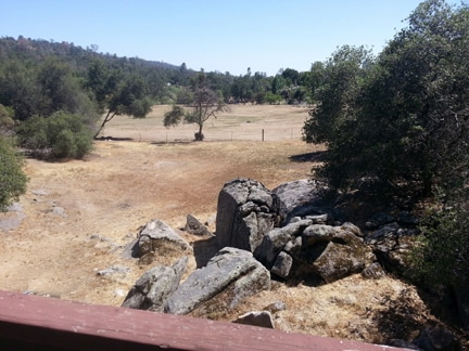 View from balcony during summer. The giant boulders below are purportedly 100 million years old!