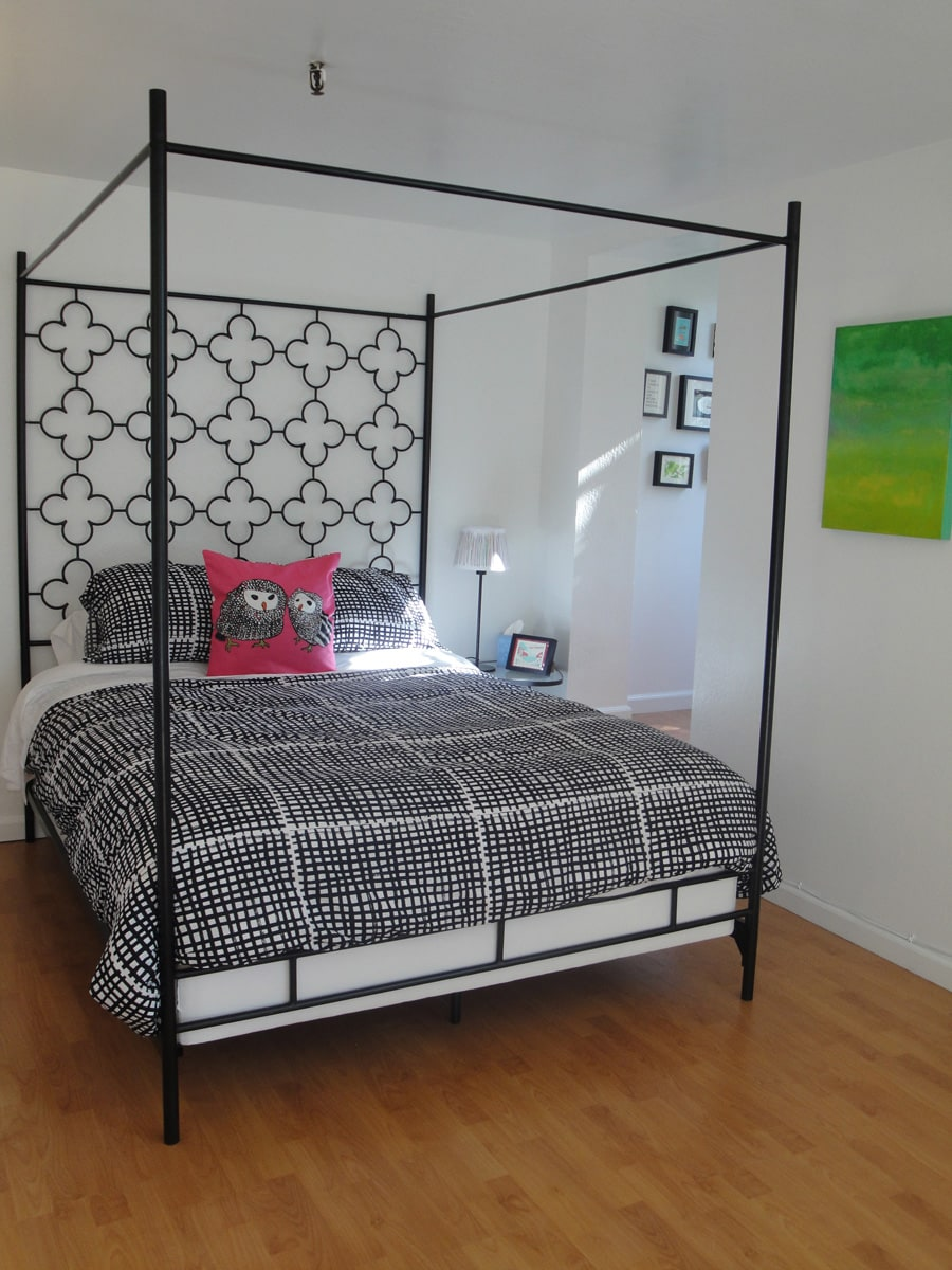 This is the queen-size canopy bed.  Off to the right is a little private nook with an adorable twin bed and window.