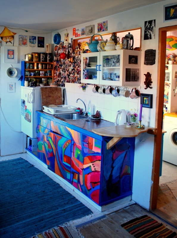 View of the kitchen with the colourful cupboard doors.