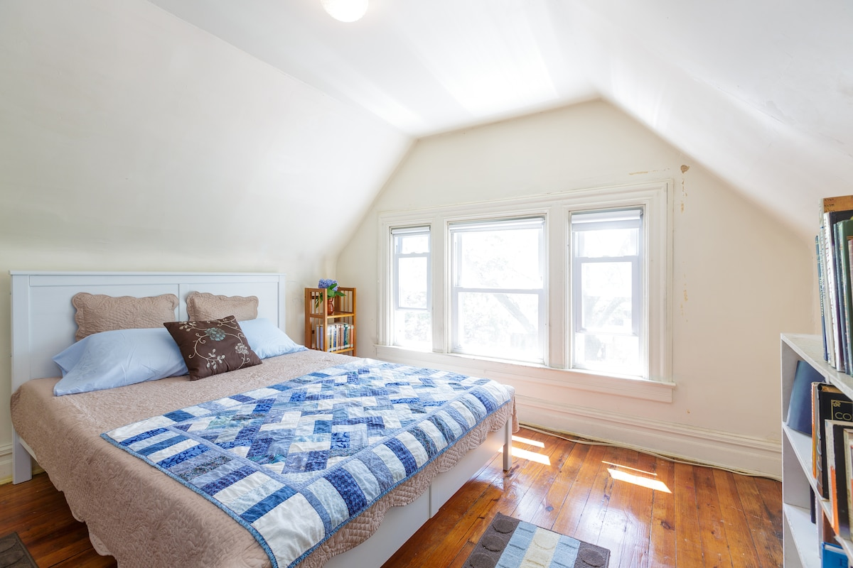 Light-filled third floor bedroom.