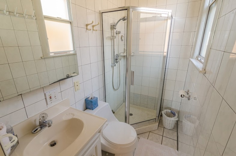 En-Suite bathroom: it's small, but it's all yours, and very clean! Towels, soap, and hair dryer provided.