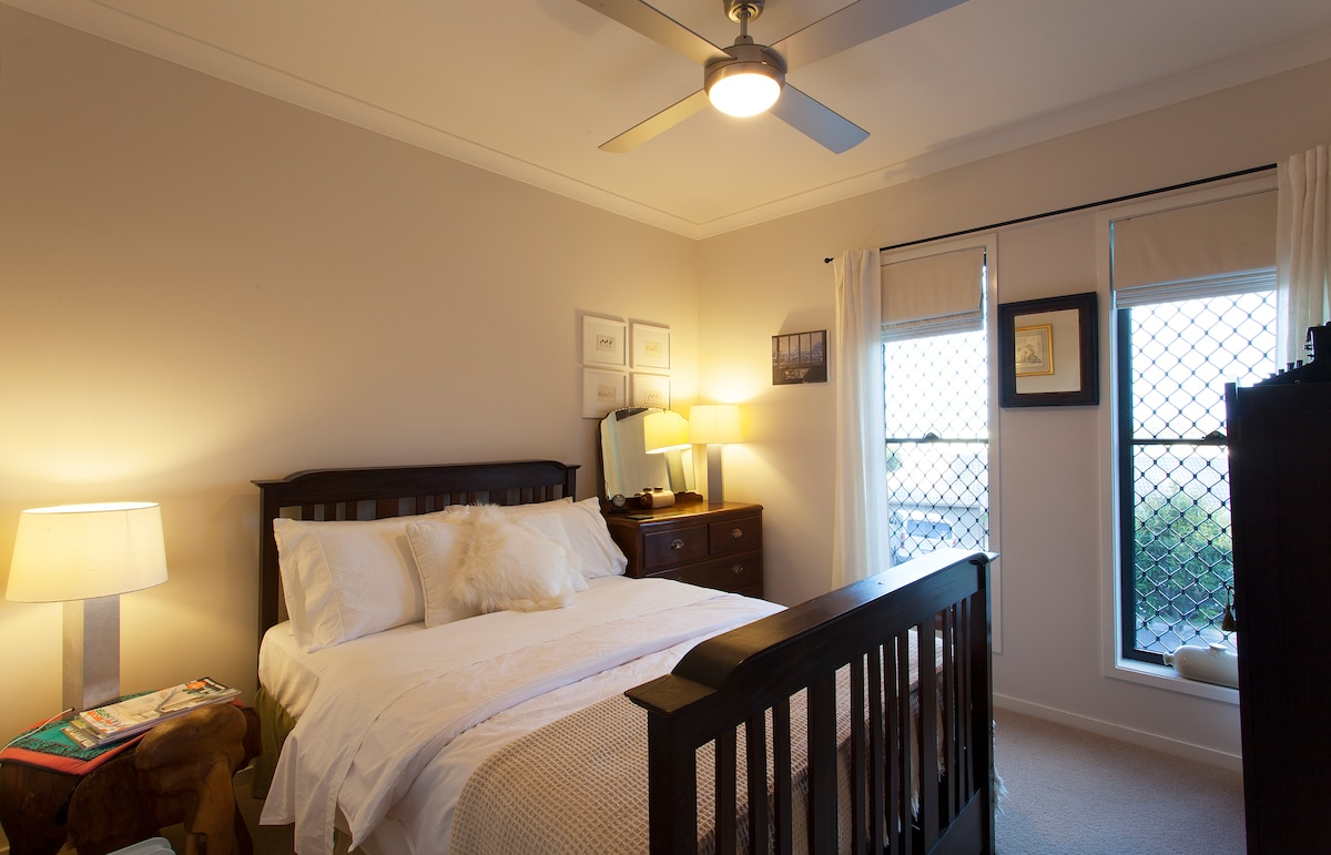 The warm comfortable bedroom with views to Mt Tibrogargan