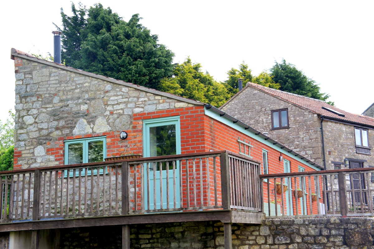 Converted barn in the curtilage of a historic Grade 2 listed property