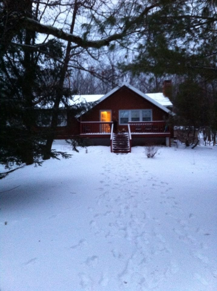 Front of cabin from street in winter time