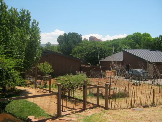 Street view. Cottage is separate from the main house with privacy fence. Cathedral Rock looms in the distance.