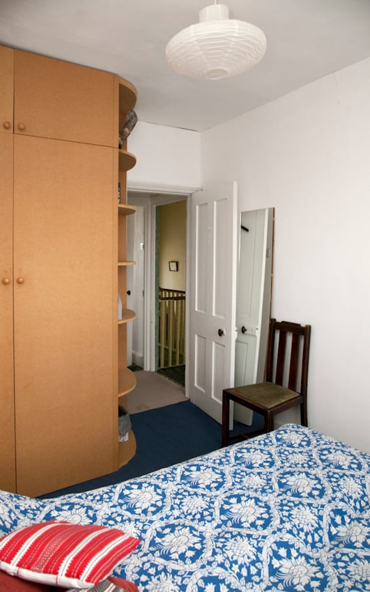Large double wardrobe has shelving both inside and outside as well as hanging space.