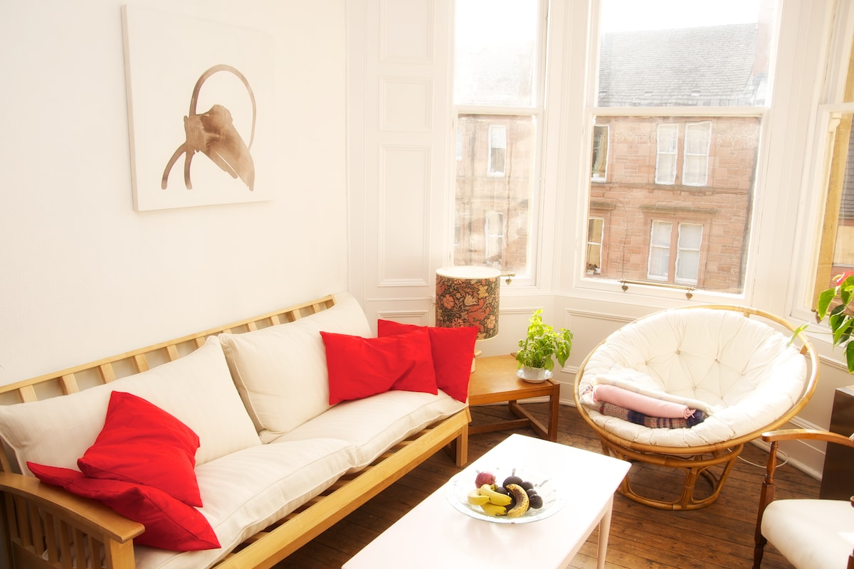 Our sunny living room for you to use- good views from the windows too!