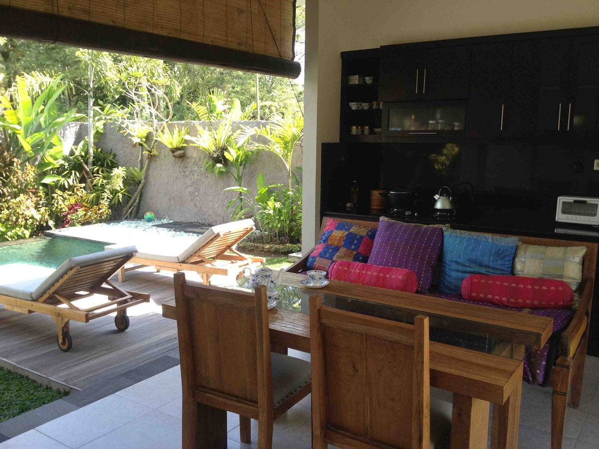 The view from the open air living room looking out at the pool and kitchen