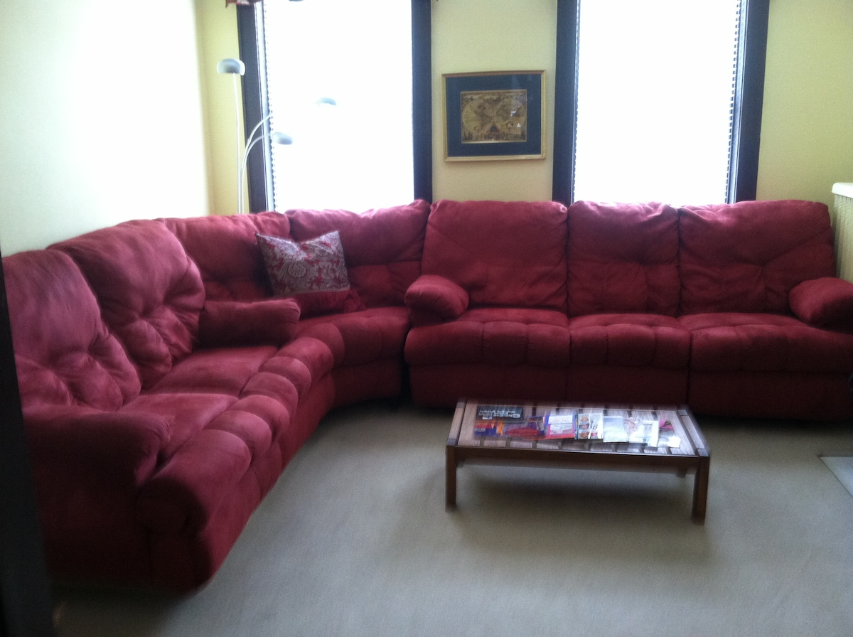 The 3 seat sofa has recliners at each end.  Also a brand new 32 inch flat screen TV...new photos shortly