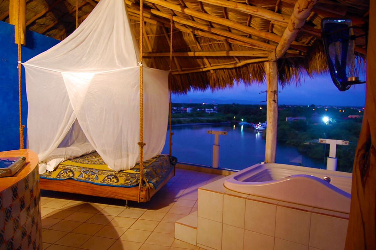 Siesta or soak? Relax on the hanging bed or in the jacuzzi.Night time picture,