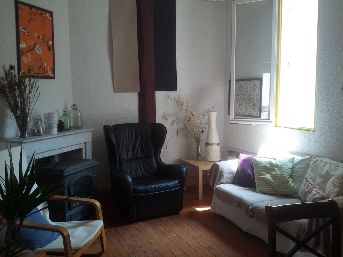 The central living space has comfortable seating for four people and a dining suite..
