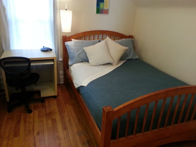 Your Bedroom 1 (4 bed pillows and 2 decorative pillows on this full-sized bed topped with memory foam!)