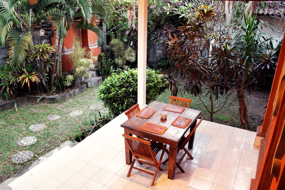 Outdoor Dining table on the front patio, Large garden leading to entrance. Total Privacy! High Walls surround the garden and villa