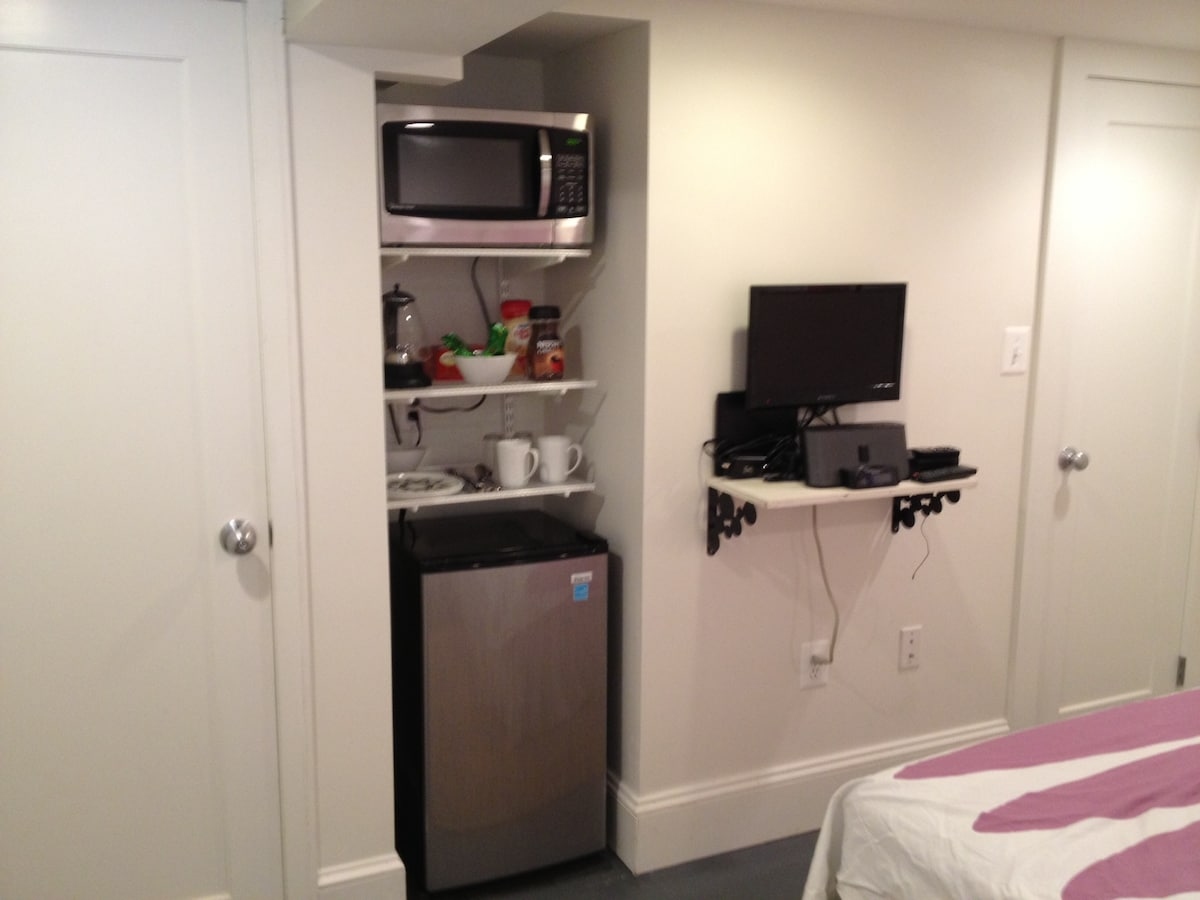 Microwave, mini fridge, electric kettle, dishes and instant coffee and tea.