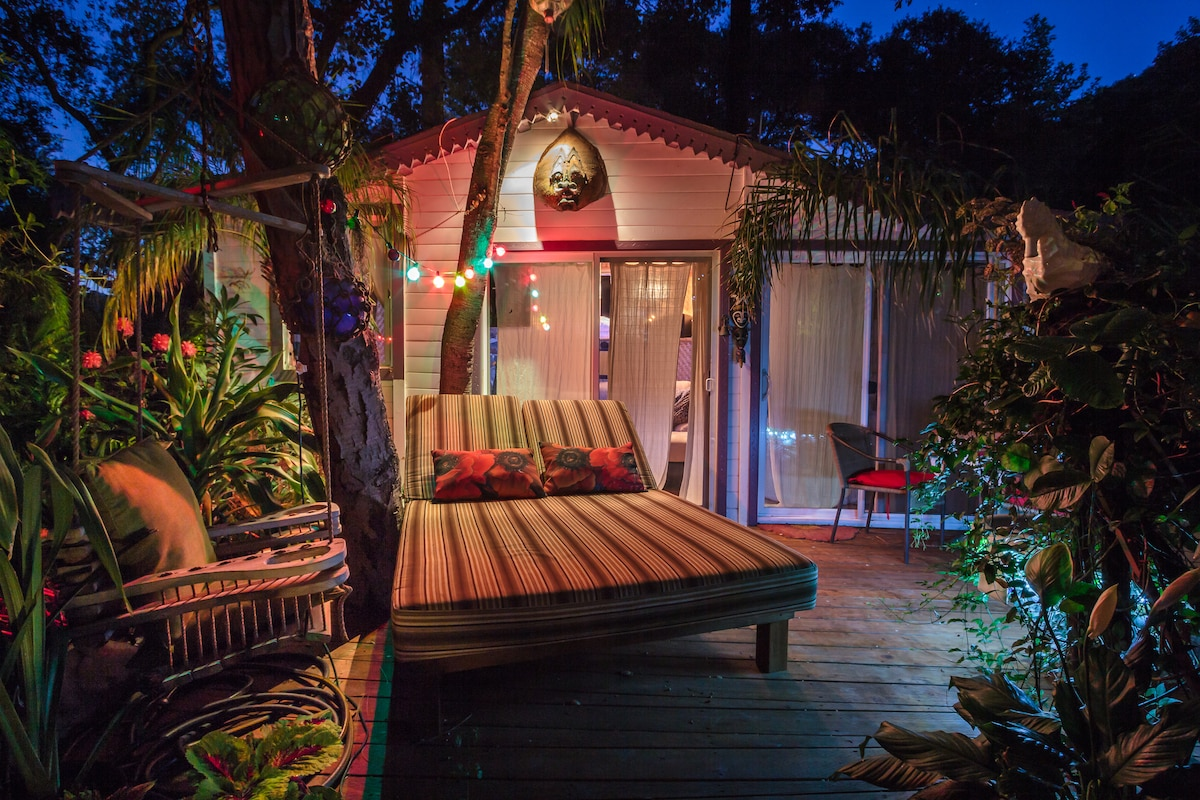 Front of guesthouse at night; shown with daybed.