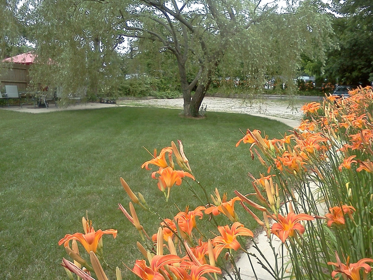 Willow, Lillies... lush backyard with patio.