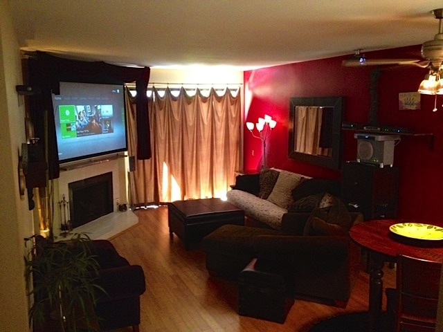 Living room features an Xbox, Apple TV, HBO, and Showtime on a 92 inch HDTV. Hardwood floors, and full size futon.