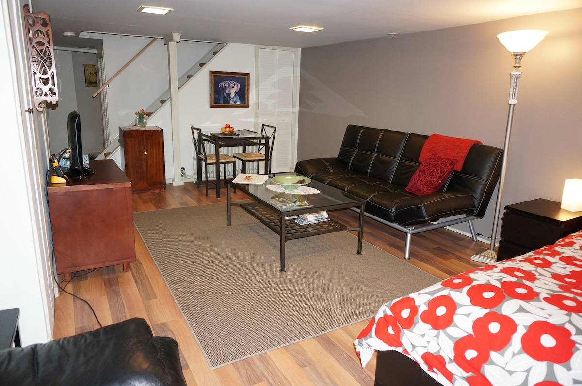 Spacious living area with leather sofa bed and romantic dining cubby