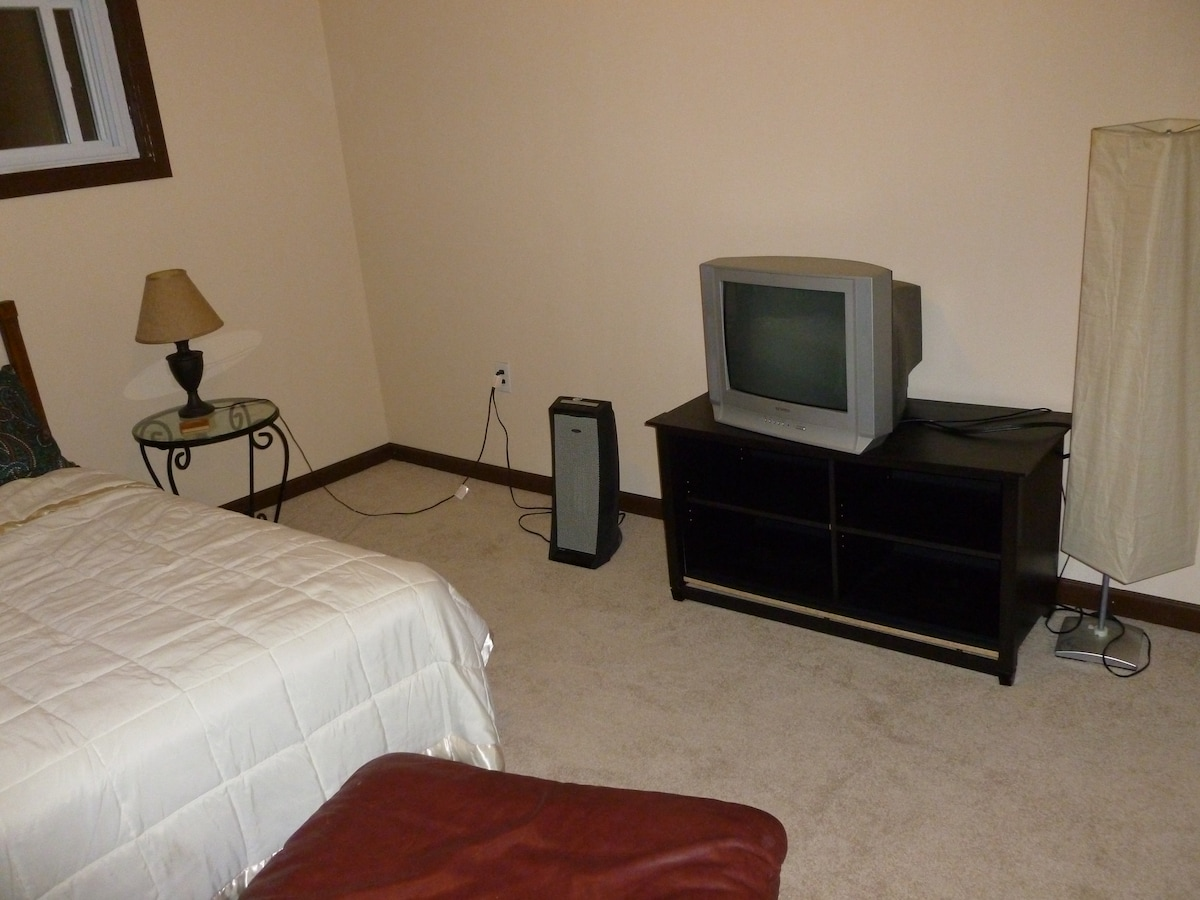The TV is now an HDTV flatscreen. Relax in the Master Bedroom with a King Sized Bed!