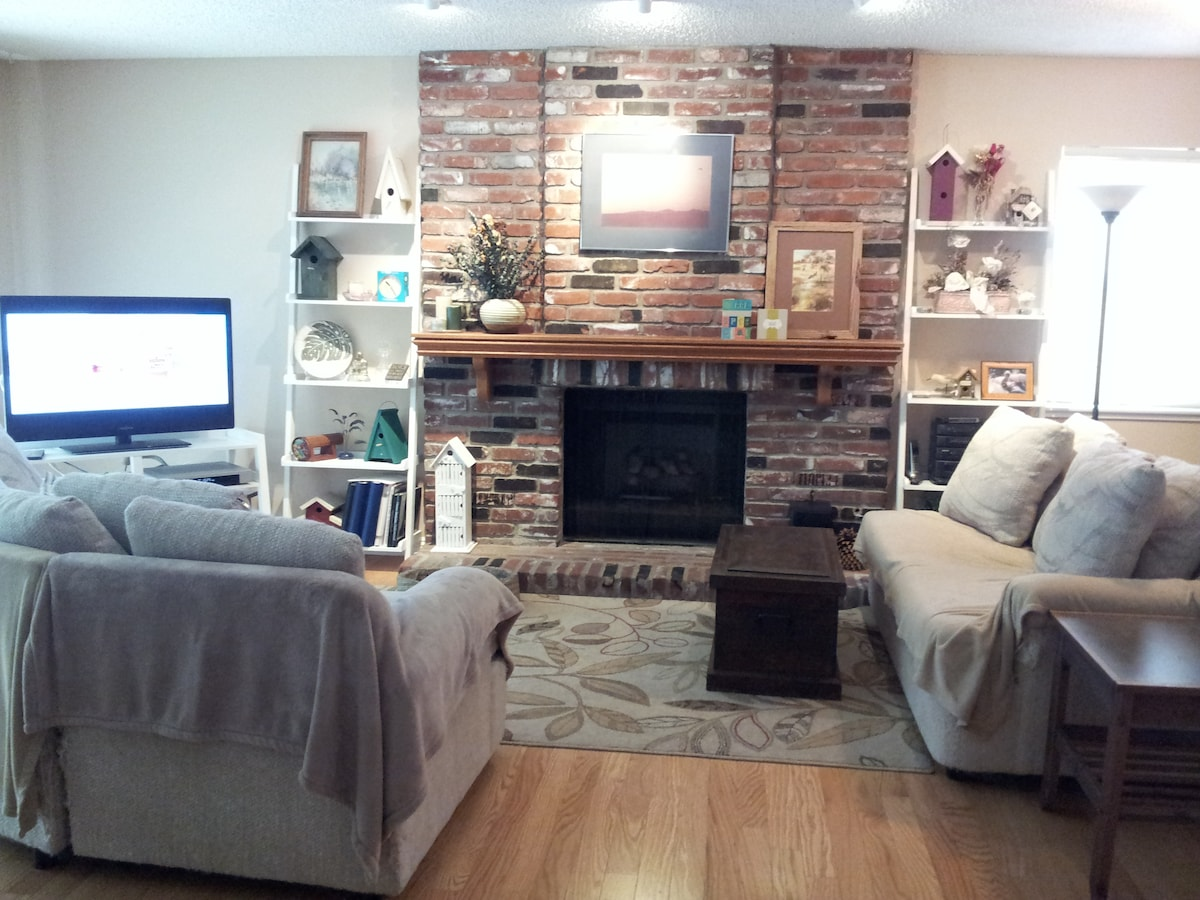 "Family room with fireplace and 42"" flatscreen TV"