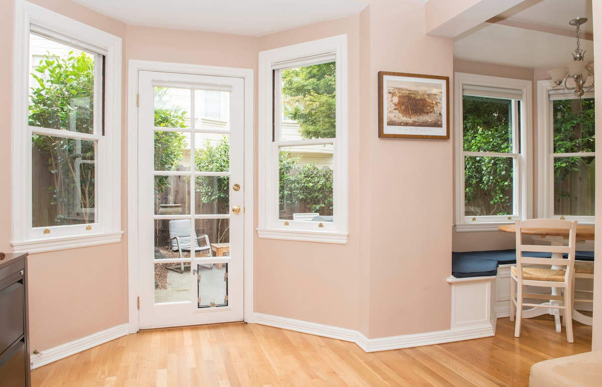 View from living room and a peek into the kitchen nook (the walls are NOT actually pink!)