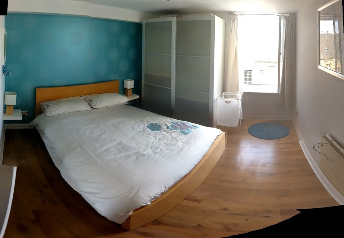 Master bedroom with double bed and generous wardrobe space