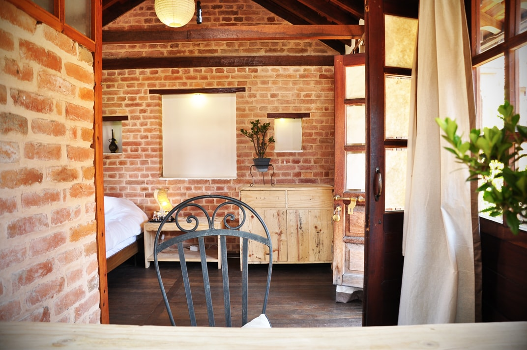 Beautiful attic single room: bricks and wood for a warm and cosy experience