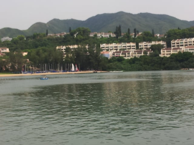 View of Ferry approaching to Discovery Bay. Beach village