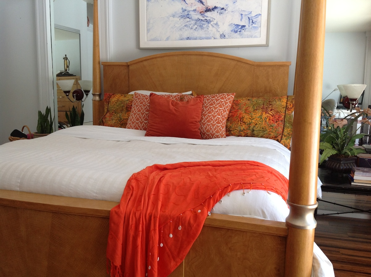 Master bedroom features a luxury king mattress with tropical accents.