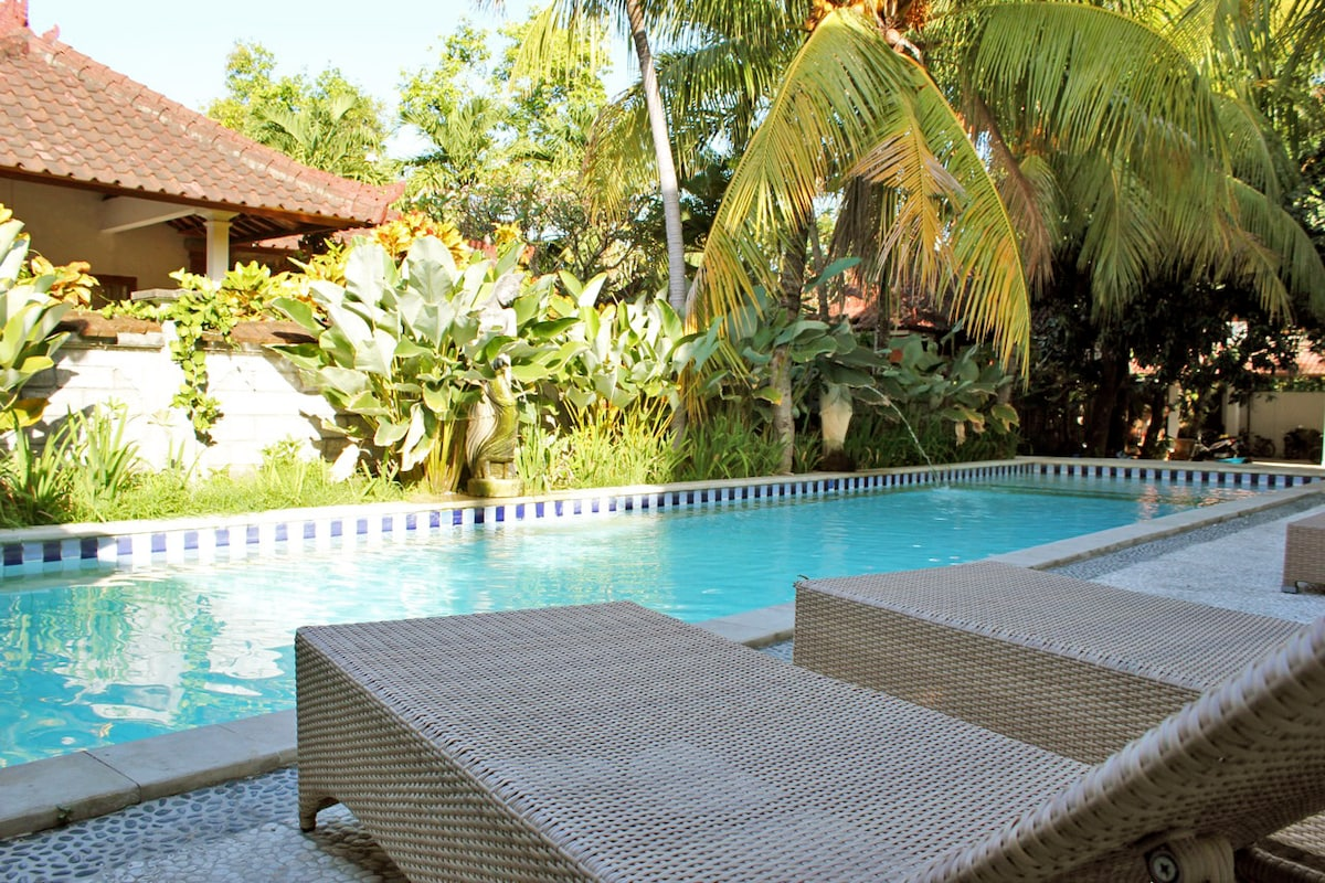 Large Nice Swimming Pool 20 meters long x 7 across. with Deck Chairs (in view) and tables.