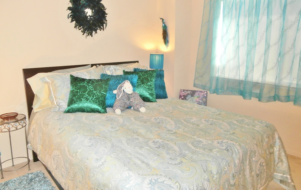This a queen bed with deluxe bedding.