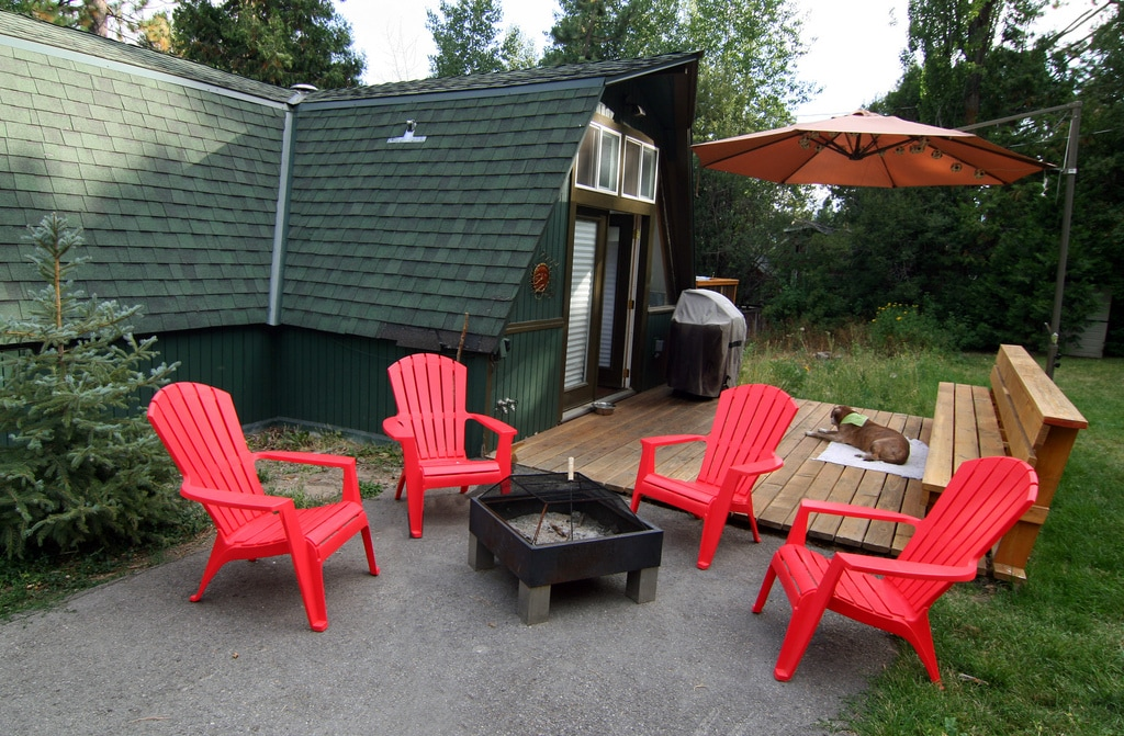 Side deck off kitchen with gas grill, shade umbrella and fire pit (neighborhood dog lounging optional)