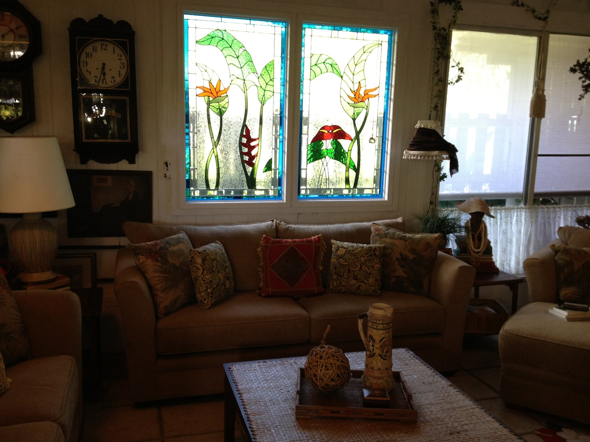 main sofa in living room with beautiful stained glass