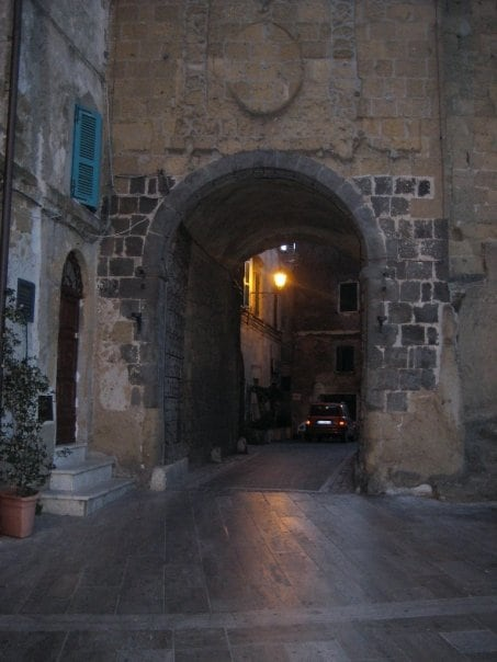 Archway below clock tower of Castle offers a welcoming and narrow entrance into the historical center of the Village.