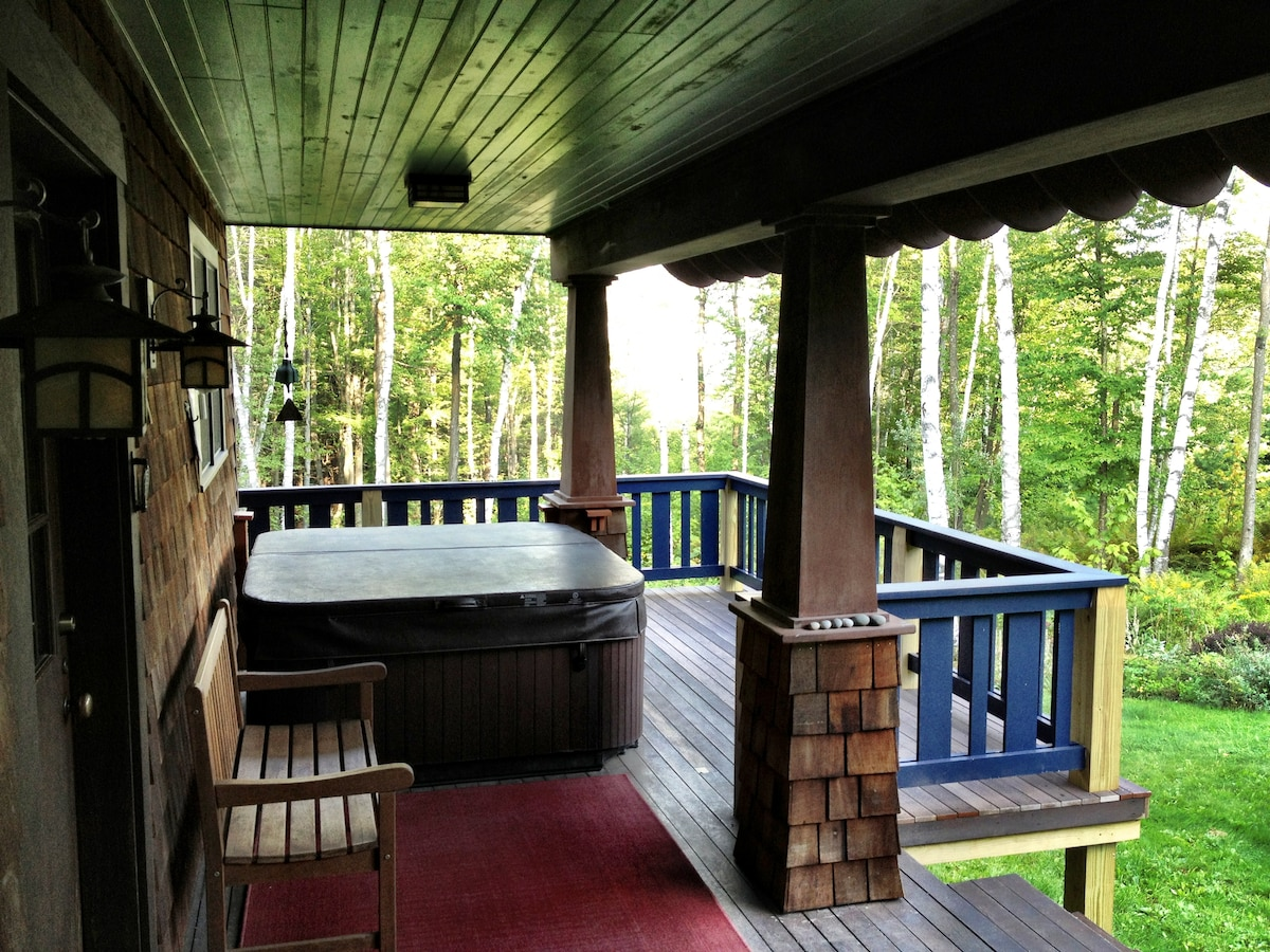 Our hot tub is covered by a roof for year-round use.