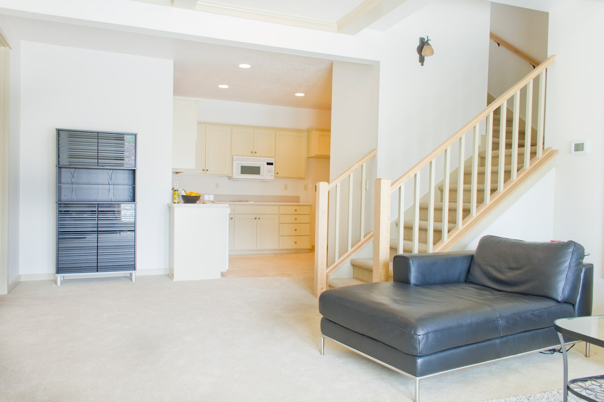 Your private kitchenette in the corner includes a sink, dishwasher, microwave, stove top, compact fridge, dishes, silverware, French press, toaster oven, pots, pans, and plenty of cabinet space.