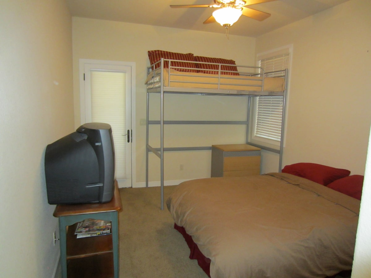 Downstairs bedroom has a double bed and a bunk bed. Door leads to hot tub and backyard.