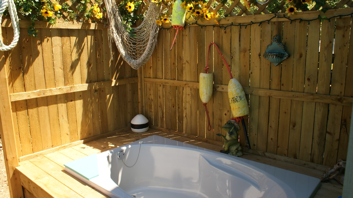 This outdoor, two seater soaker tub will warm your soul while you watch the ocean by day, the stars by night - oh , the stars, the stars so many, sooo bright