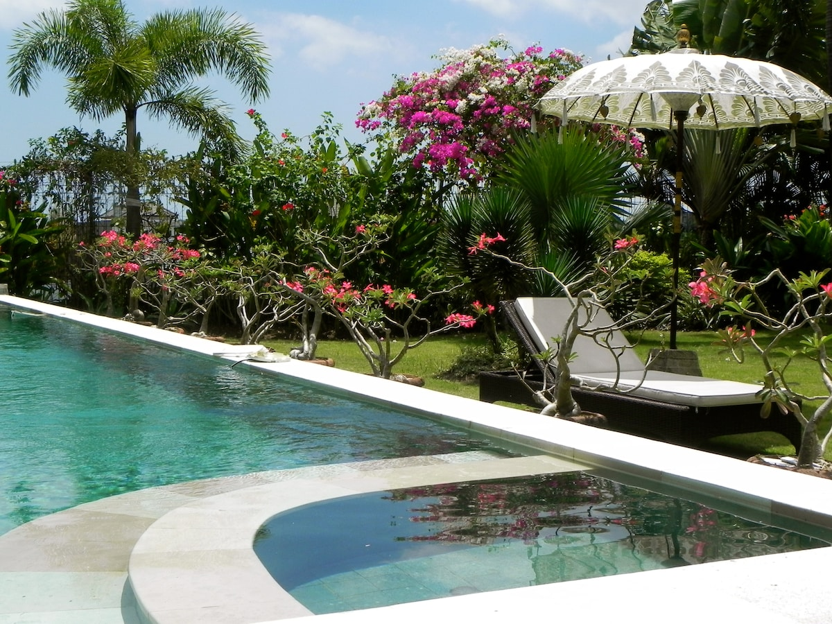 tropical plants in full blossom  and saltwater pool