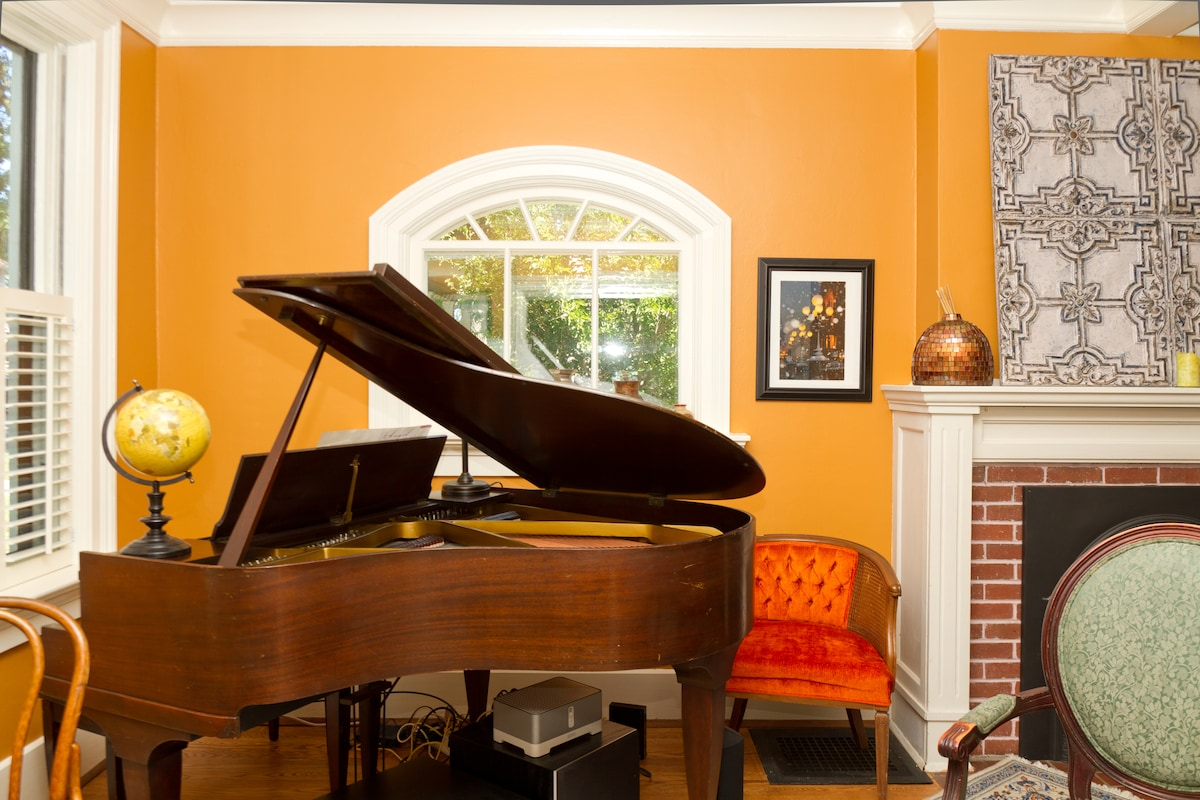Baby grand piano in front of living room