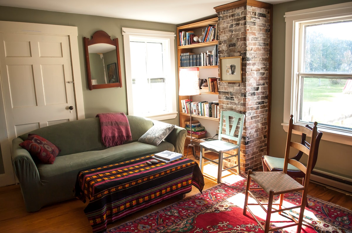 A sunny living room looks out over the pastures