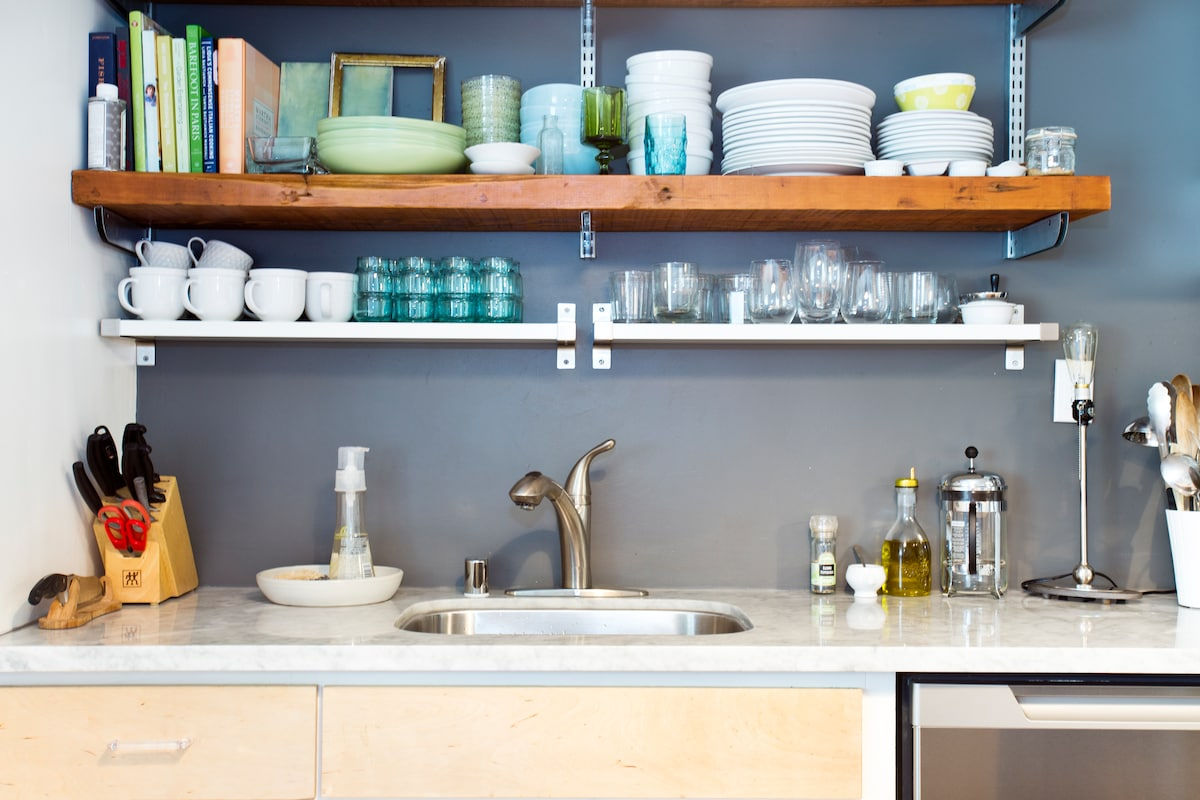 Stainless steel dishwasher and marble countertop