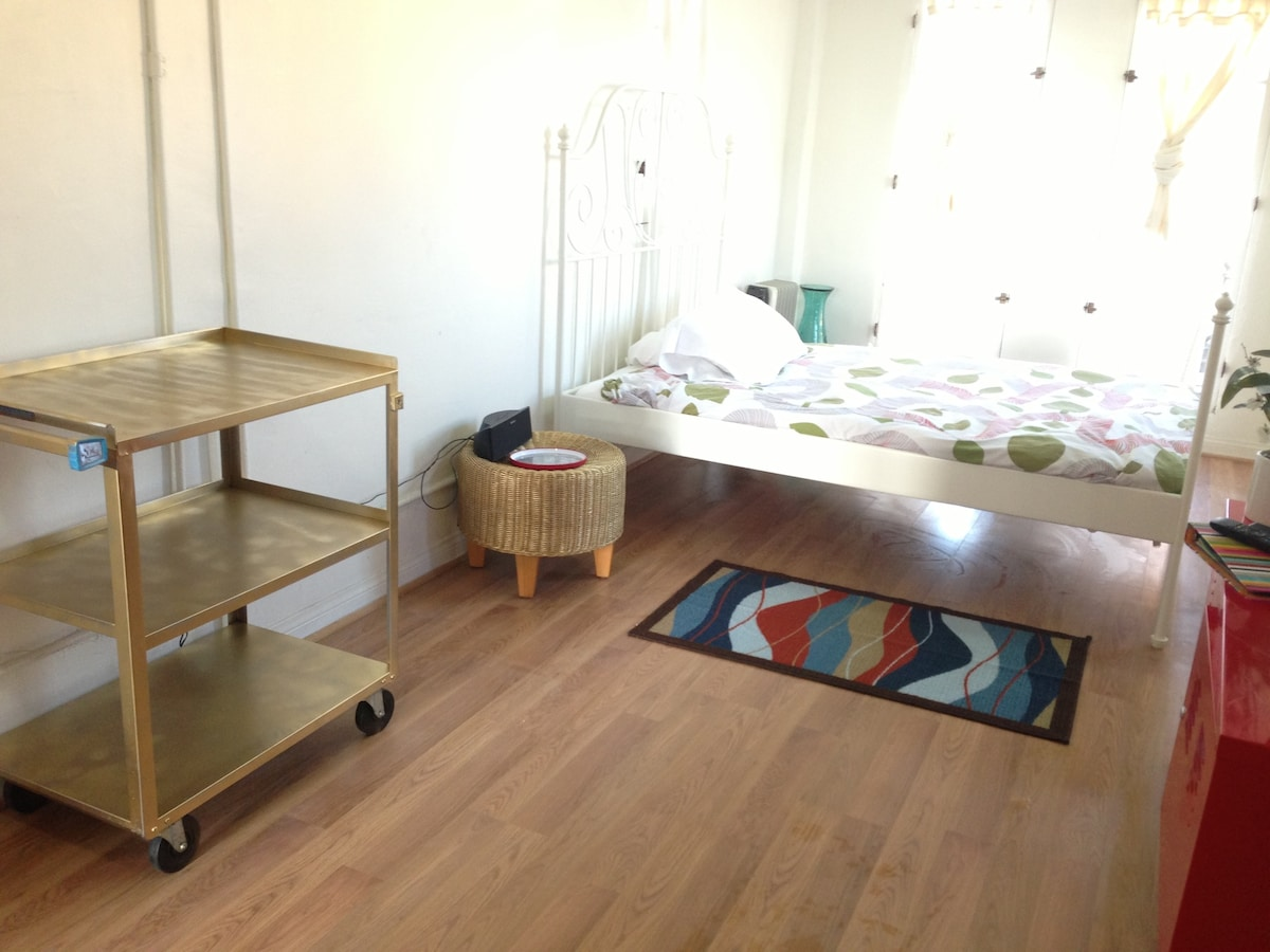 Gold Suitcase and clothing shelf . Cute DIY gold night stand :-)